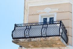 Trellised iron balconies in the old brick house. TAGANROG, RUSSIA - June 26, 2017: Trellised iron balconies in the old brick house outside against the background Royalty Free Stock Photography