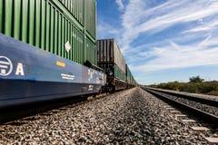Trem da carga que apressa-se na trilha Foto de Stock Royalty Free