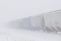 Trem da grão na neve de sopro Fotografia de Stock Royalty Free