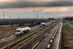 Trem de caminhões de tanque em uma estrada da estrada foto de stock royalty free