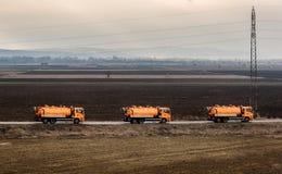 Trem de caminhões de tanque em uma estrada da estrada fotografia de stock royalty free