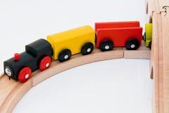 Trem de madeira do brinquedo na estrada de ferro Fotografia de Stock