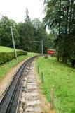 Trem de Pilatus da montagem Pilatus nos cumes suíços Imagens de Stock