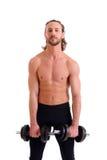 Trem exercitado do corpo do homem novo com barra-sino Fotos de Stock Royalty Free