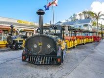 Trem famoso do búzio do turista na rua de Duval em Key West, Florida Fotos de Stock Royalty Free