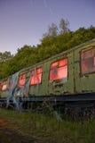 Trem na luz dos tapumes pintada Imagens de Stock Royalty Free