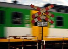 Trem que cruza as trilhas que waworning Imagem de Stock Royalty Free