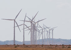 Trembling air. A group of wind turbines in the sizzling desert heat. Aragon, Spain Royalty Free Stock Photo