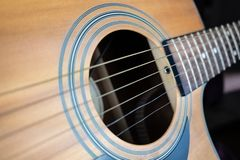 Trembling guitar string, electronic shutter distortion effect. Close-up image of resonating strings captured with wave effect royalty free stock photography