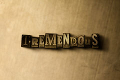 TREMENDOUS - close-up of grungy vintage typeset word on metal backdrop. Royalty free stock illustration. Can be used for online banner ads and direct mail royalty free illustration