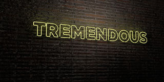TREMENDOUS -Realistic Neon Sign on Brick Wall background - 3D rendered royalty free stock image. Can be used for online banner ads and direct mailers stock illustration