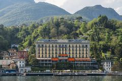 Front facade of grand luxurious hotel overlooking Lake Como stock photography