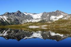 Tremor Mountain and Mount Macbeth. Reflected in Russet Lake (Garibaldi Park, British Columbia, Canada Stock Photo