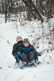 Trenó das crianças no inverno no ar fresco Imagem de Stock Royalty Free