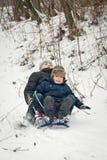 Trenó das crianças no inverno no ar fresco Fotografia de Stock