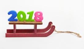 Trenó decorativo de madeira com os números 2018 Foto de Stock Royalty Free
