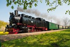 Tren alemán histórico del vapor en primavera Imágenes de archivo libres de regalías