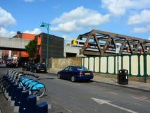 Tren, bicis y coches Foto de archivo libre de regalías
