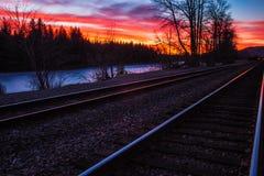 Tren de la puesta del sol Imagenes de archivo