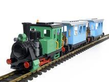 Tren del juguete del estaño con las cartas Fotografía de archivo libre de regalías