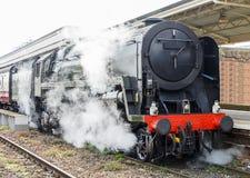 Tren del vapor en la estación Imagenes de archivo