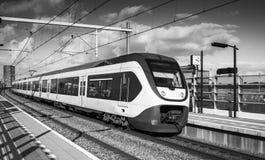 Tren eléctrico del pasajero, blanco y negro Fotos de archivo libres de regalías