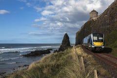Tren que emerge del túnel Foto de archivo libre de regalías