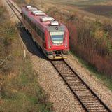 Tren rojo en los carriles Imagen de archivo libre de regalías