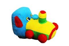 Tren suave coloreado del juguete en un fondo blanco imagen de archivo libre de regalías