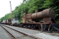 Tren y carro averiados del vapor Imagen de archivo