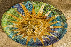 Trencadís broken tile mosaics on the ceiling at Park Guell stock image
