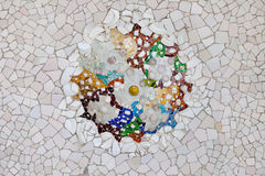 Trencadis Mosaic in Park Guell in Barcelona. Trencadis mosaic from broken tile shards on the ceiling of Hypostyle Room in Park Guell, Barcelona, Catalonia, Spain Royalty Free Stock Photo