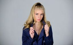 Trench coat fashion trend. Must have concept. Woman makeup face blonde hair posing coat with collar. Fashionable coat. Clothes and accessory. Girl fashion royalty free stock photography