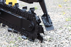 Trench digger machine for trenching Stock Image