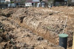 Trench dug by hand under the Foundation or for laying drainage. A trench dug by hand under the Foundation or for laying drainage stock images