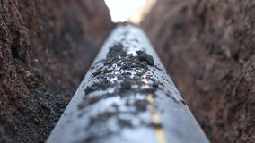 A trench with a gas pipeline. A trench with a gas  pipeline, polypropylene pipe stock footage