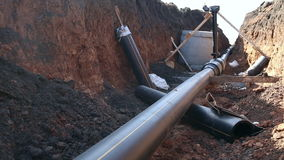 A trench with a gas pipeline. A trench with a gas  pipeline, polypropylene pipe, installation of a tie-in and a well stock video footage
