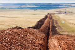 Trench for laying oil pipes Stock Images