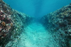 Trench underwater into ocean floor Pacific ocean. Natural trench underwater carved into the ocean floor on the outer reef of Huahine island, Pacific ocean stock images