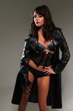 Trenchcoat. Beautiful young brunette in lingerie and trenchcoat Royalty Free Stock Photo