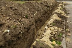 Trenches dug city, Ukraine digs trenches. Trenches dug in the city, Ukraine digs trenches stock photos