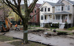 Trenches have been dug on a Chicago residential. Trenches have been dug on a residential street in Chicago in preparation for sewer pipe replacement Stock Images