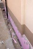 Trenching around building for new layer of foam insulation 2 Stock Photography