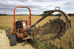 Trenching machine. Old style trenching machine in the field Stock Photography