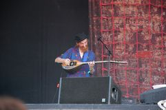 Trencin, Slovakia - July 9, 2011: Lu Edmonds playing bouzouki live with Public Image limited PIL, ex Sex Pistols at Pohoda Festi
