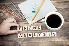 Trend Analysis. Wooden letters on the office desk royalty free stock image