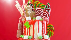 On trend Candy land Christmas drip cake. stock images