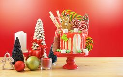 On trend Candy land Christmas drip cake. stock photos