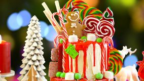 On trend Candy land Christmas drip cake. royalty free stock photography