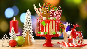 On trend Candy land Christmas drip cake. stock photo